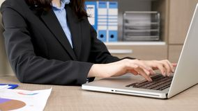 close-up-businesswoman-hands-typing-laptop-close-up-businesswoman-hands-typing-laptop-desk-her-office-114219396